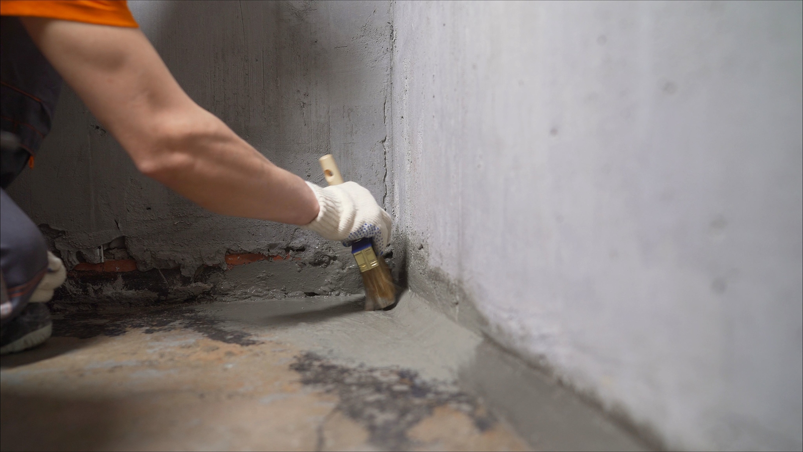 Waterproofing Concrete Floor With Mortar And Brush. An Industria