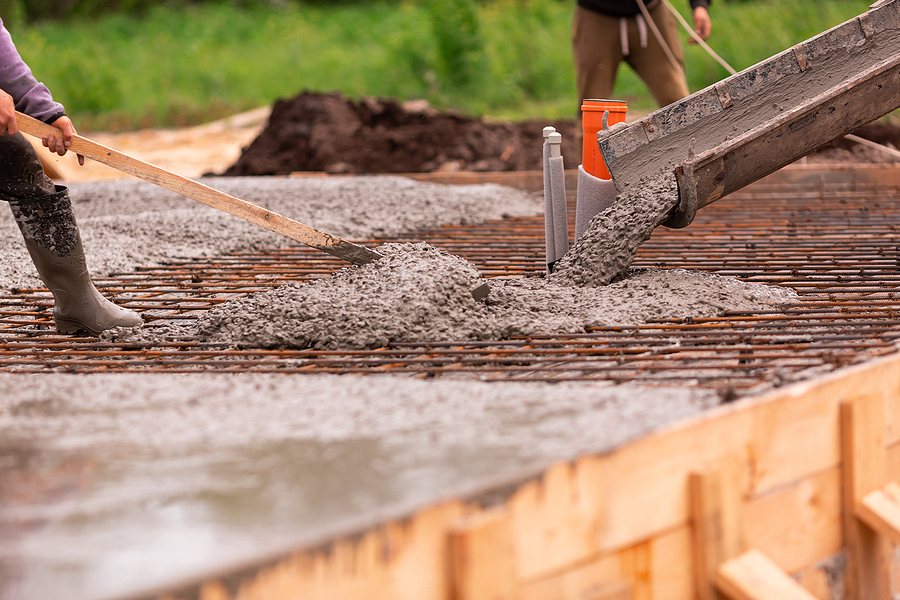 Lay Of The Cement Or Concrete Into The Foundation Formwork From